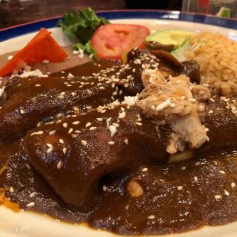 Chicken enchiladas in mole sauce (Mi Tierra)